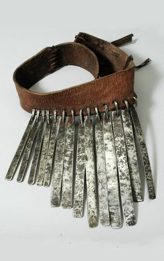 Africa | Cache sexe / apron from the Bari people of Bahr el Jebel Singi, South Sudan | Worn by very young girls | Leather and metal | ca. prior to 1940.