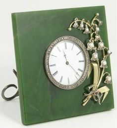 Russian jade and silver Wigstrom clock. Has a stunning art deco jeweled  floral design over jade square plaque with round face to center. Elite Decorative Arts, Anniversary Sale, Boynton Beach FL, Sept 24th