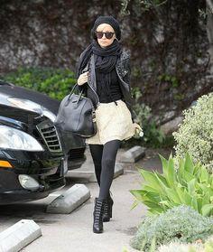 nicole richie black tights black leather jacket scarf cream skirt.