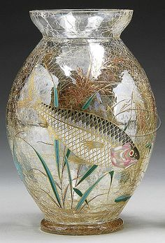 A Moser glass vase depicting fish -amber craquel vase with two large enameled fish swimming amongst seaweed. Czechoslovakia, c1895-1925