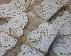 Paper Doilies wrapped around invitations