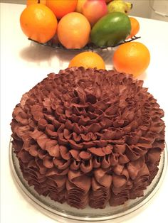 Ruffle chocolate cake. Cake decoration buttercream flower.