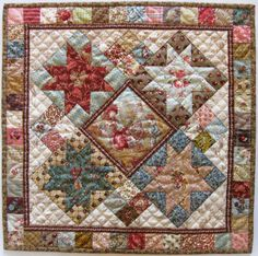 "Doll quilt ""Kaatje"" is made by Jeanneke. This is by far my most favourite mini quilt! The center is a wonderful piece of Toile du Jouy fabric. Total size 44 x 44 cm.  From www.quilt-it.nl/patronen"