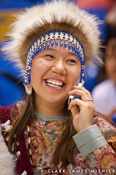 Young Yup'ik woman with tradtional headdress talks on cell phone at the World Eskimo and Indian Olympics, Fairbanks, Alaska,USA Native American Regalia, Native American Beauty, Native American History, Alaska Usa, Just Smile, First Nations, People Around The World, Portrait, Headdress