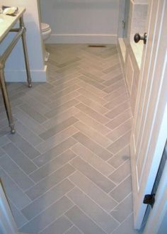 Need source- gray herringbone tile Bathroom tile, floors Grey Flooring, Gray Tile Bathroom Floor, Kitchen Flooring, Bathroom Makeover, Flooring, Bathroom Flooring, Entryway Flooring, Bathrooms Remodel, Herringbone Tile Floors