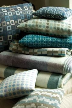 aqua blankets, throws and cushions.Melin Tregwynt modern welsh heritage