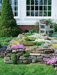 steinmauer gartenideen mit farbenfrohen pflanzen