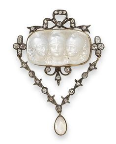 A late 19th century moonstone cameo and diamond brooch.