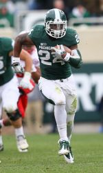 Michigan State junior Le'Veon Bell, who led the Big Ten and ranked third in the NCAA Football Bowl Subdivision in rushing at 137.9 yards per game, has been named First-Team All-American by CollegeFootballNews.com. The CFN staff takes postseason bowl performances into account when selecting its All-America Teams.