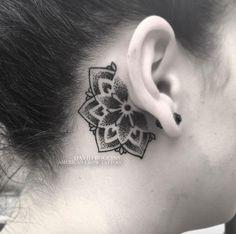 Behind-the-ear mandala flower tattoo by David Boggins