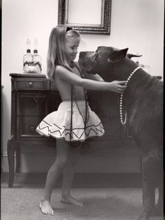 Little girl and her great dane.