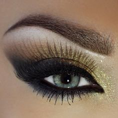 Smudged out cat eye with golds and bronze eyes shadows