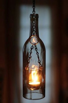 Wine bottle lanterns - 26 Highly Creative Wine Bottle DIY Projects to Pursue – Wine bottle lanterns Reuse Wine Bottles, Wine Bottle Lanterns, Wine Bottle Art, Bottle Lights, Wine Bottle Crafts, Wine Bottle Lighting, Decorative Wine Bottles, Empty Liquor Bottles, Wine Bottle Chandelier