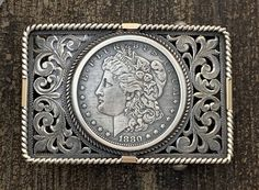 From master silversmith Clint Orms the Angelina features handcut and engraved filigree, twisted silver wire rope edge with gold accent and a Morgan silver dollar. Fits a belt. Awesome and heirloom quality hand made in Texas. Metal Engraving, Carving Designs, West Texas, Morgan Silver Dollar, Gold Accents, Belt Buckles, Belts, Concept Art, Ties