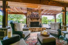 Custom outdoor retreat, complete with an outdoor fireplace.  Built by Backyard Retreats (281) 485-8483
