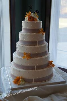 Sweet Life Bakery, Vineland, NJ - Serving Philly, to LBI, to Cape May and beyond! thesweetlifebakery.com #weddingcake #teamsweetlife #orchids #5tierweddingcake #fondantband #buttercreamdots #runningdeer