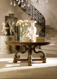 <3<3   This is an exquisite foyer. I love the iron railing and curvature of the stairs...adds subtle but dynamic panache. The mirror in the foreground really complements the base of the table. I have to emulate ;)