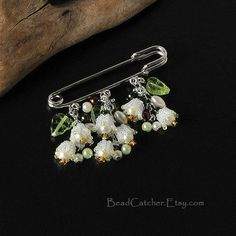 Lily of the valley spring pin by BeadCatcher on Etsy, $45.00-Make it with safety pin and broken jewlery or beads.