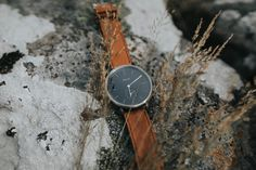 A classic timepiece. An everyday watch, featuring a black dial, cordovan tan leather strap [with visible stitching] with a brushed silver casing. Our commuter range each features 'Glasgow' on every dial. The perfect watch for both men and women, for any season.