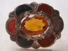 The use of crystals as ornaments goes back to at least the 14th century.  Cairngorm and agate.