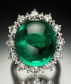 This emerald and diamond piece may be worn as a ring or pendant. The emerald is 19.41 ct, 17.70 x 15.80 x 10.00 mm and is one of the few emeralds in the collection to be enhanced (clarity).
