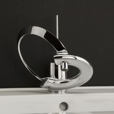 Google Image Result for http://www.graceinottawa.com/images/Modern-Bathroom-Faucets-With-Curved-Levers-%25E2%2580%2593-Embrace-Lacava-0.jpg