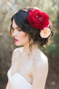 Match a red lip with bold red floral accessories on your wedding day. Red lips bridal look Awesome headpiece btw