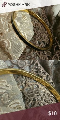 Kate Spade Black Draw The Line Bangle Bracelet Black enamel and gold plated bangle bracelet by Kate Spade. Excellent condition, only worn a few times. Perfect for stacking bangles. Two available. kate spade Jewelry Bracelets