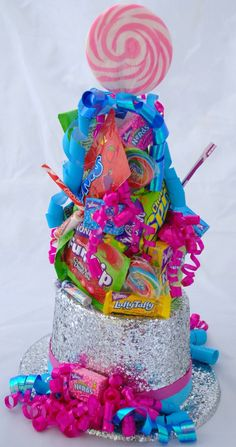 Willy Wonka Top Hat Candy Centerpiece.  This is a centerpiece we created for a Willy Wonka themed Bat Mitzvah.  The kids loved it!