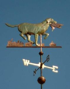 Labrador Retriever Dog Weathervane Running with Duck by West Coast Weather Vanes.  Glass eye color can be selected to accommodate a  variety of dog eye colors.  Personalized dog weathervanes can feature gold-leafing to bring out your pet's distinctive markings, as well as dog collars bearing your dog's name.