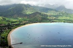 Hanalei Bay, Kauai - Snorkeled here.. and started down the Napali Coast... Puff the Magic  Dragon and Hanalei go together.