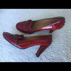 Tod's Cranberry Patent Leather High Heel Loafer Italian made. Authentic Tod's Jodie Loafer. Cranberry red patent leather. Gentle used but scuffed in storage. Size 9.5. Great for that boardroom bombshell! Tod's Shoes Heels
