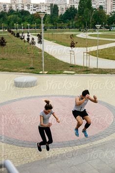 Young couple working out in urban environment by Aleksandar Novoselski - Training, Jumping - Stocksy United Urban Fitness, Young Couples, Environment, The Unit, Training, Stock Photos, Workout, Work Outs, Environmental Psychology