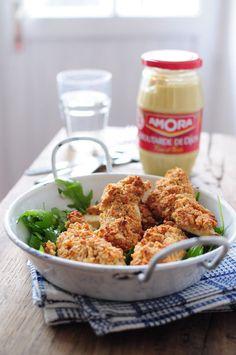 Aiguillettes de poulet enrobées d'une croûte cacahuètes et moutarde (cuit au four avec pour résultat une viande tendre et parfumée)