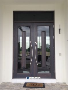 Unique and contemporary custom front doors! Double mahogany wood doors with glass and floating pyramid panels. The modern curved pulls add an extra element to this style. Iron Front Door, Double Front Doors, Iron Doors, Porch Doors, House Doors, Entrance Doors, Entrance Ideas, Door Ideas, Wood Exterior Door