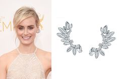 Taylor Schilling of the Netflix series Orange is the New Black wore Forevermark's cuff earrings, which boasted pear-shaped and round brilliant diamonds set in 18-karat white gold.