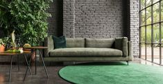 Sofa with a distinctive structure featuring a slim body holding soft cushions. You can find the Danny Sofa at Voyager