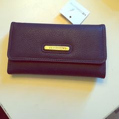 Liz Claiborne NAVY wallet Perfect, new condition. Standard inside with 13 card compartments, checkbook slot, Id holder, and cash compartments. Change compartment on outside Liz Claiborne Accessories Key & Card Holders