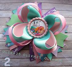 This Listing is for One Hair Bow Paw Patrol Style! This bow will bring a great mood for its owner and other people. The Bow: -5-5,5 Inches (approx.) - 3 layers -Heat sealed -Alligator clip, scrunchy, French barrette   If your little angel loves to play dress up, she will love these adorable stacked bows! These clip-in bows come in a variety of designs and girly colours, and feature kids favourite Disney Princesses and cartoon characters. All bows are handmade by me from Petersham ribbon…