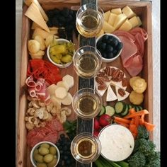 A delectable charcuterie board with bourbon, meats, cheeses and fruits. A delectable charcuterie board with bourbon, meats, cheeses and fruits. Plateau Charcuterie, Charcuterie And Cheese Board, Charcuterie Platter, Cheese Boards, Snack Platter, Party Food Platters, Cheese Platters, Meat Appetizers, Appetizers For Party