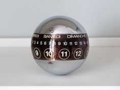 Vintage Silver Ball Calendar: Weighted ball with three rotating rings. #Calendar #Ball