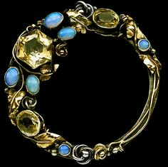 Dorrie Nossiter. Silver, gold, citrine and opal brooch. Sold by Tadema Gallery.