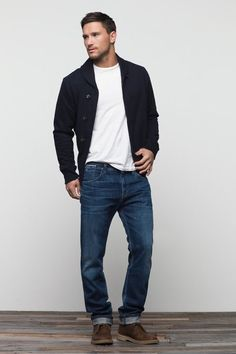 For an everyday outfit that is full of character and personality consider teaming a black shawl cardigan with blue jeans. Round off this look with dark brown leather chukka boots.  Shop this look for $131:  http://lookastic.com/men/looks/white-crew-neck-t-shirt-black-shawl-cardigan-blue-jeans-dark-brown-desert-boots/7021  — White Crew-neck T-shirt  — Black Shawl Cardigan  — Blue Jeans  — Dark Brown Leather Desert Boots