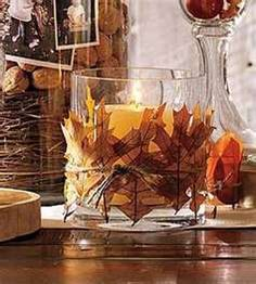 Wrap leaves around a glass candle votive with twine..perfect!