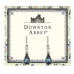Simple and classy, these beautiful pear-shaped earrings feature a rich Montana blue pear-shaped crystal with glass crystal stones embedded at the post. Presented on a Downton Abbey-themed card.