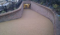 Resin bound paving installed on a driveway at Herts, leading to underground garage, completed at a depth of using daltex yellow aggregate, on Underground Garage, Dream Boards, Dream Rooms, Pavement, Garages, Car Garage, Basement Ideas, Ph, Trust