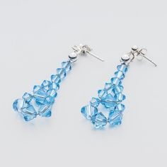 Swarovski Bicone Earrings 45mm Aquamarine  Dimensions: length: 4,5cm stone size: 4 and 6mm Weight ( silver) ~ 0,90g ( 1 pair ) Weight ( silver + stones) ~ 3,90g Metal : sterling silver ( AG-925) Stones: Swarovski Elements 5328 4 & 6mm Colour: Aquamarine 1 package = 1 pair  Price 7 EUR