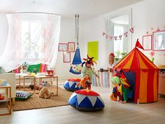 Love the swing and large floor cushions. Maybe too much circus theme though.