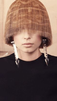"""Barcelona-based photographer and fashion filmmaker Gustavo Lopez Mañas has collaborated with hairdressers from Madrid-based fashion styling company X-presion to produce what they call """"the first hair collection in cinemagraph."""" The project, known as Sketch, presents a series of animated images featuring elaborately styled models making subtle movements."""