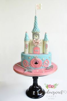 Pink and blue Cinderella Castle Cake, with a carriage, wand, and a shiny slipper!